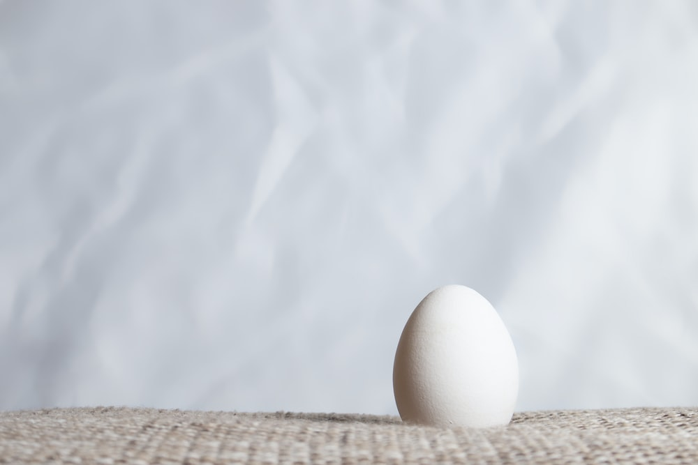 white egg on brown woven basket