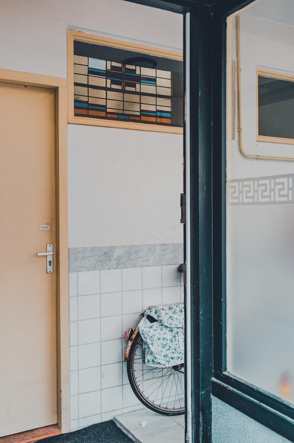 white wooden door near white wall tiles