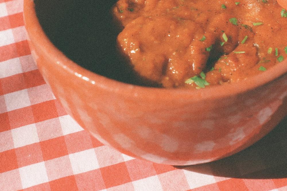 cooked food in brown ceramic bowl