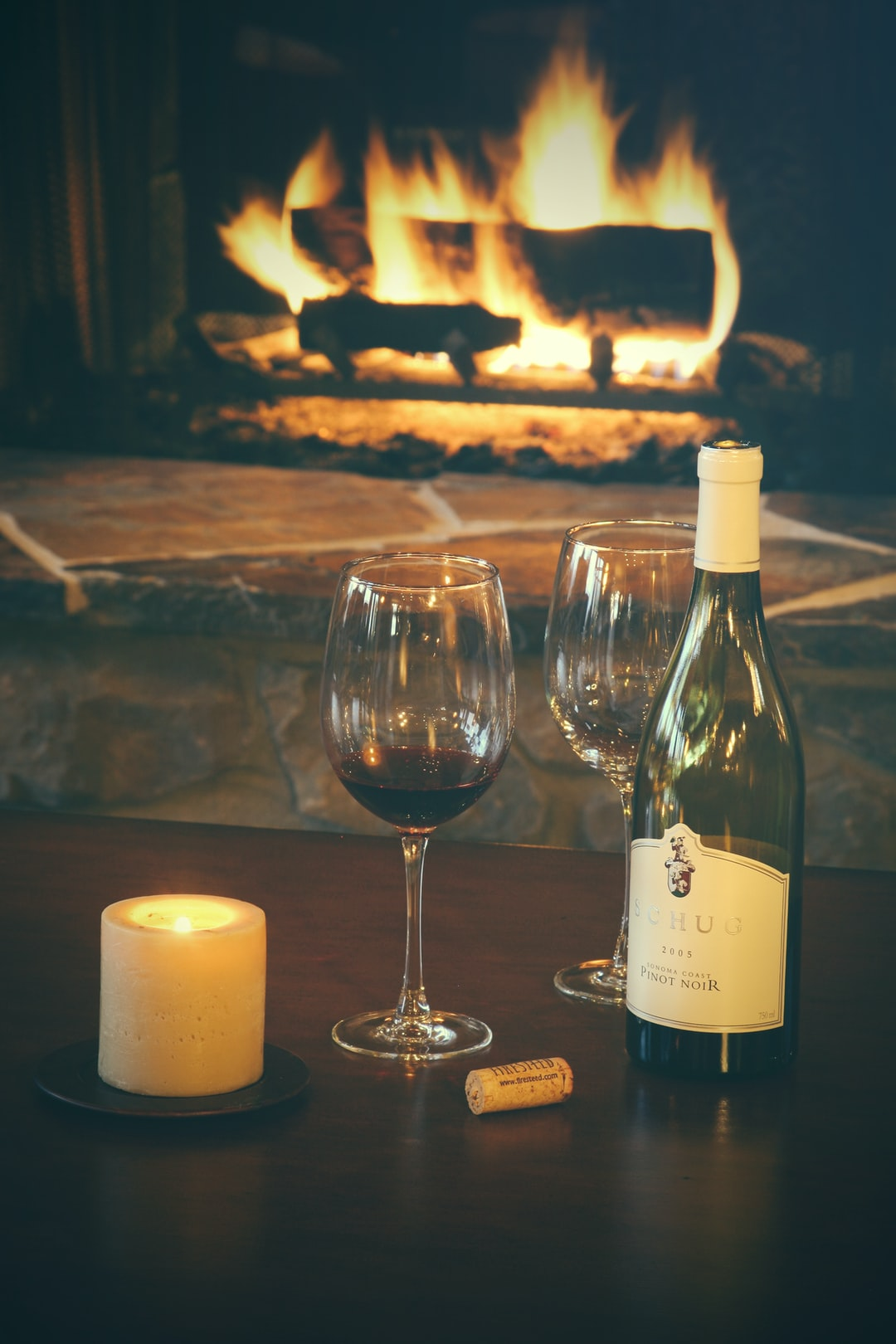 Wine in front of the fireplace