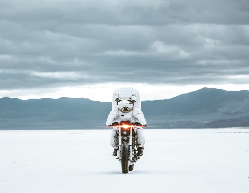 white motorcycle on snow covered ground during daytime
