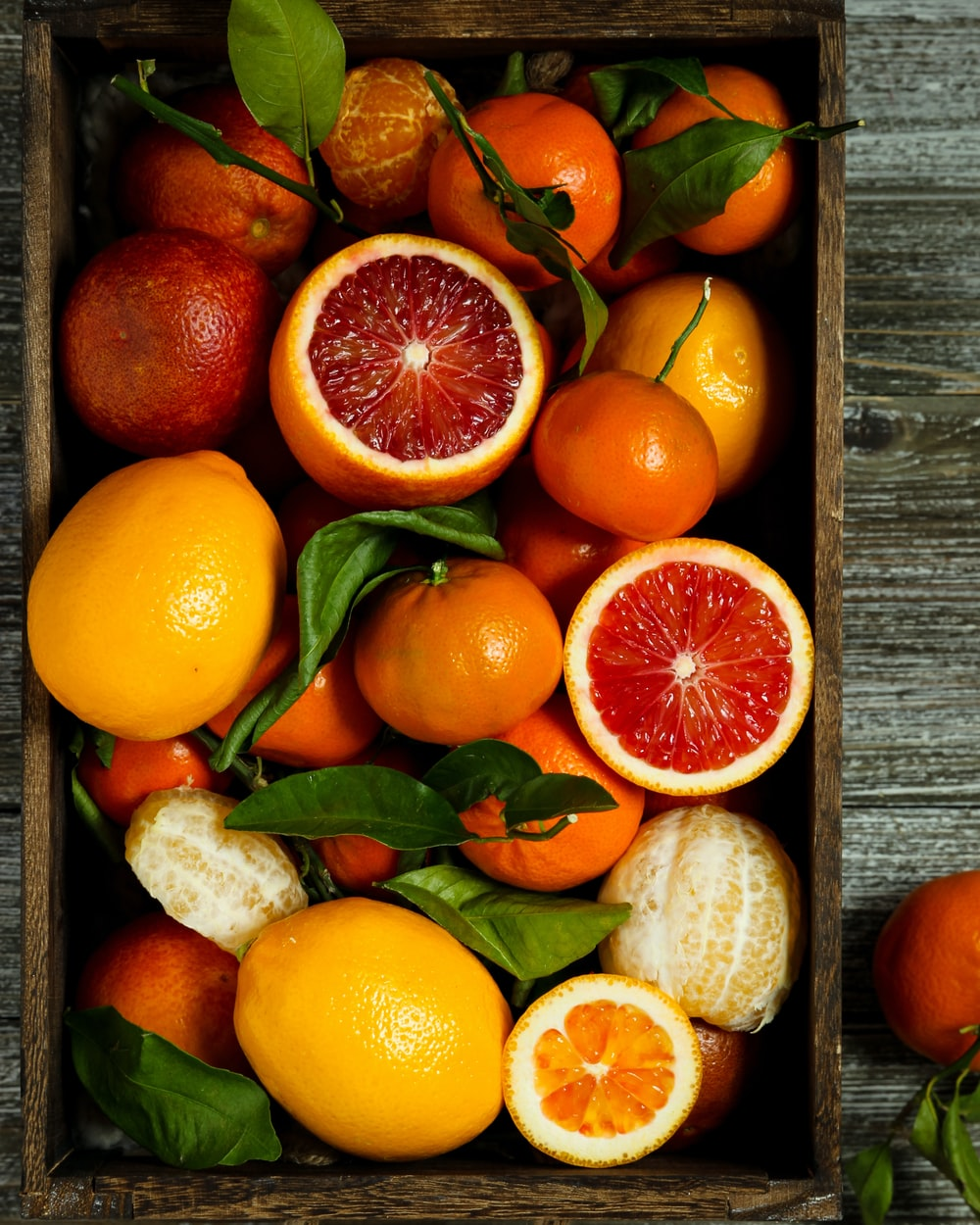 orange fruits on brown wooden table