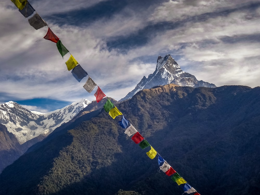 red yellow and green flag on top of mountain