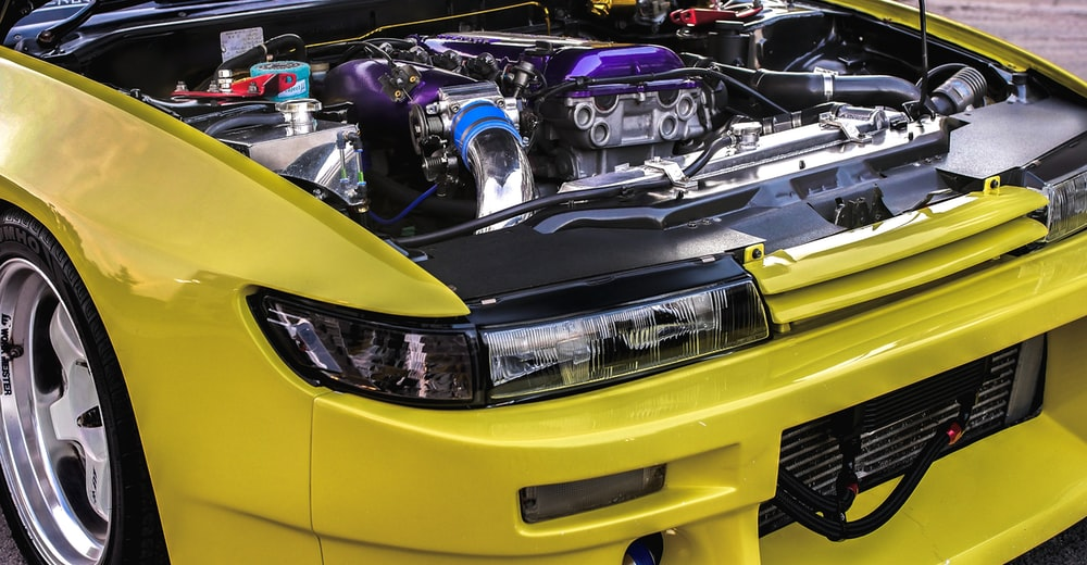 yellow and black car engine bay