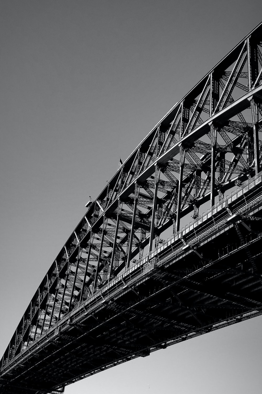 grayscale photo of metal bridge