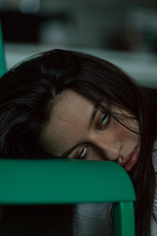 woman lying on green textile