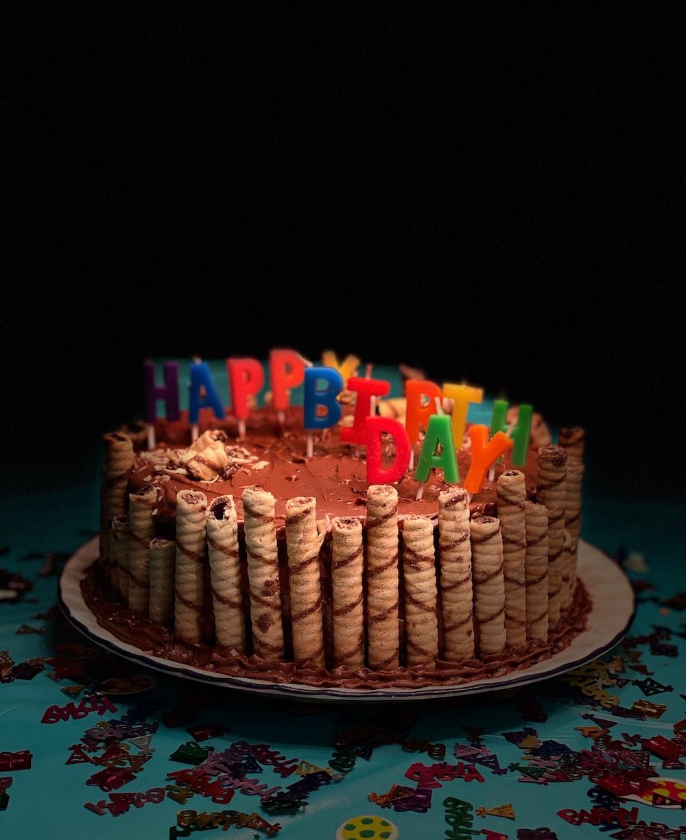 Happy Birthday Cake With Happy Birthday Candles Photo Free Birthday Cake Image On Unsplash