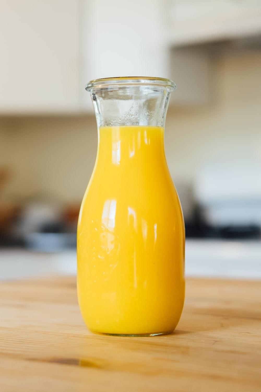 yellow liquid in clear glass bottle