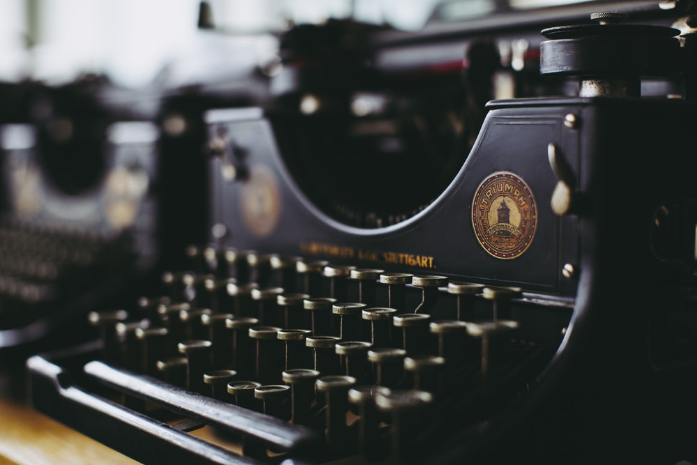 black and white typewriter in close up photography
