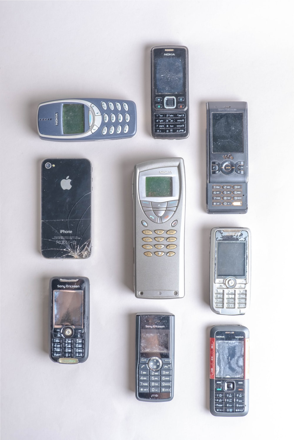 assorted color candybar phones on white surface