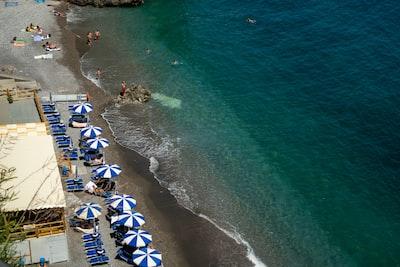 people on beach during daytime amalfi coast teams background