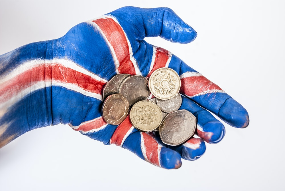 person in blue red and white long sleeve shirt wearing silver round coins