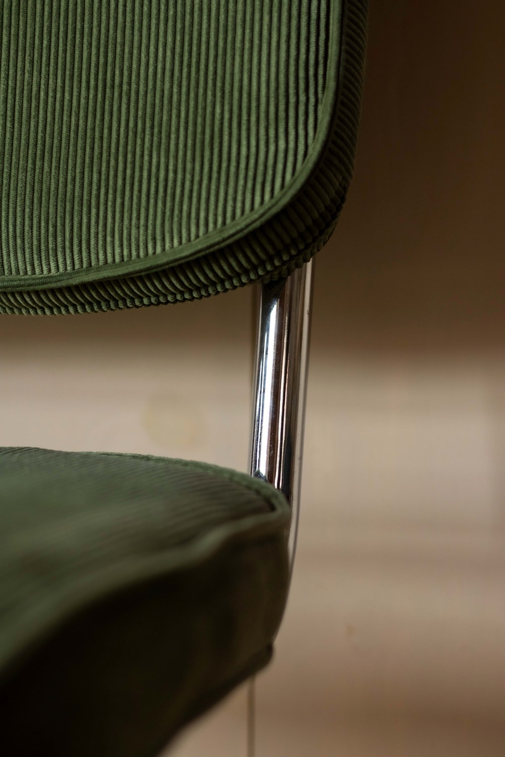 green and black chair on brown floor