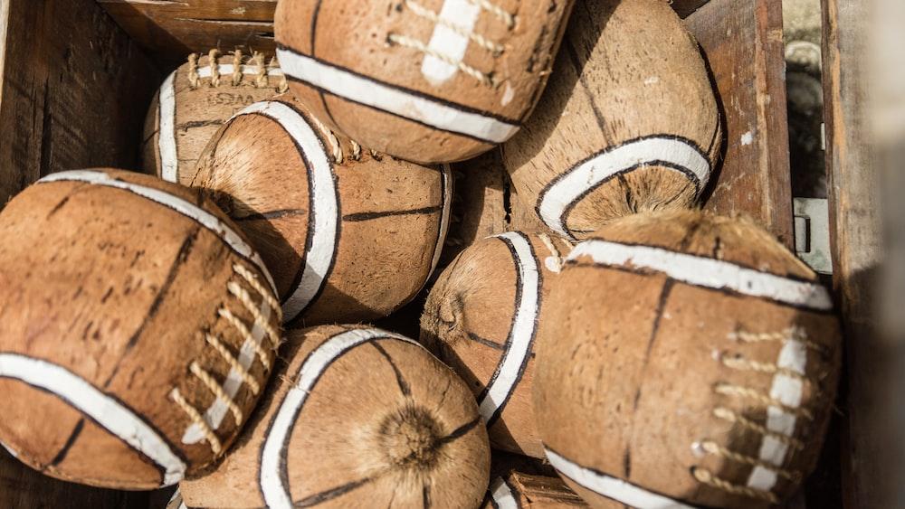 brown wooden barrels on brown wooden crate