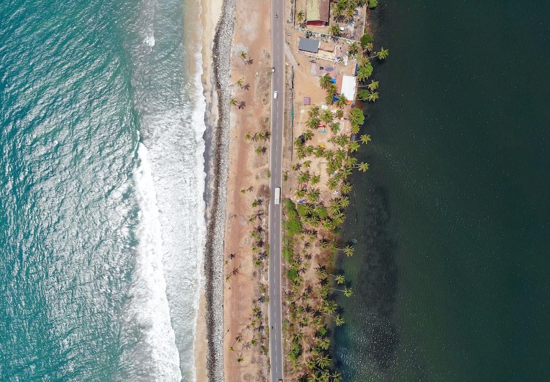 A narrow road separating the lake and ocean