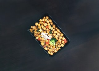 brown and black food in black rectangular tray
