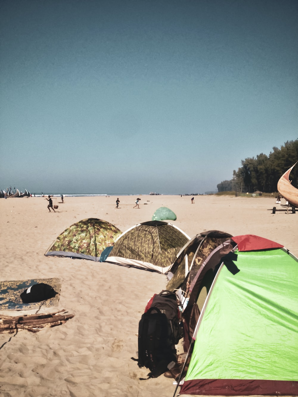 green tent on beach during daytime