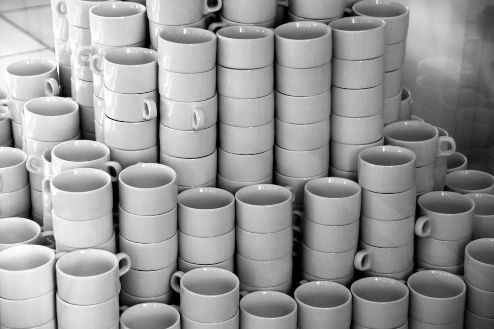 white ceramic mugs on white ceramic plate
