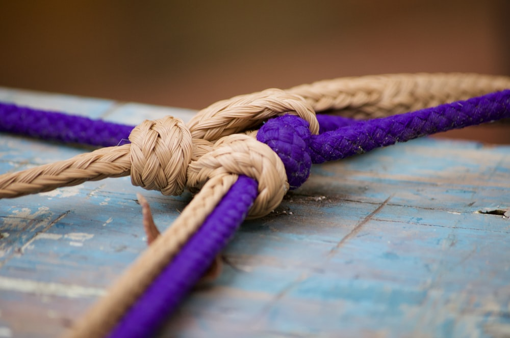 brown rope on blue wooden table