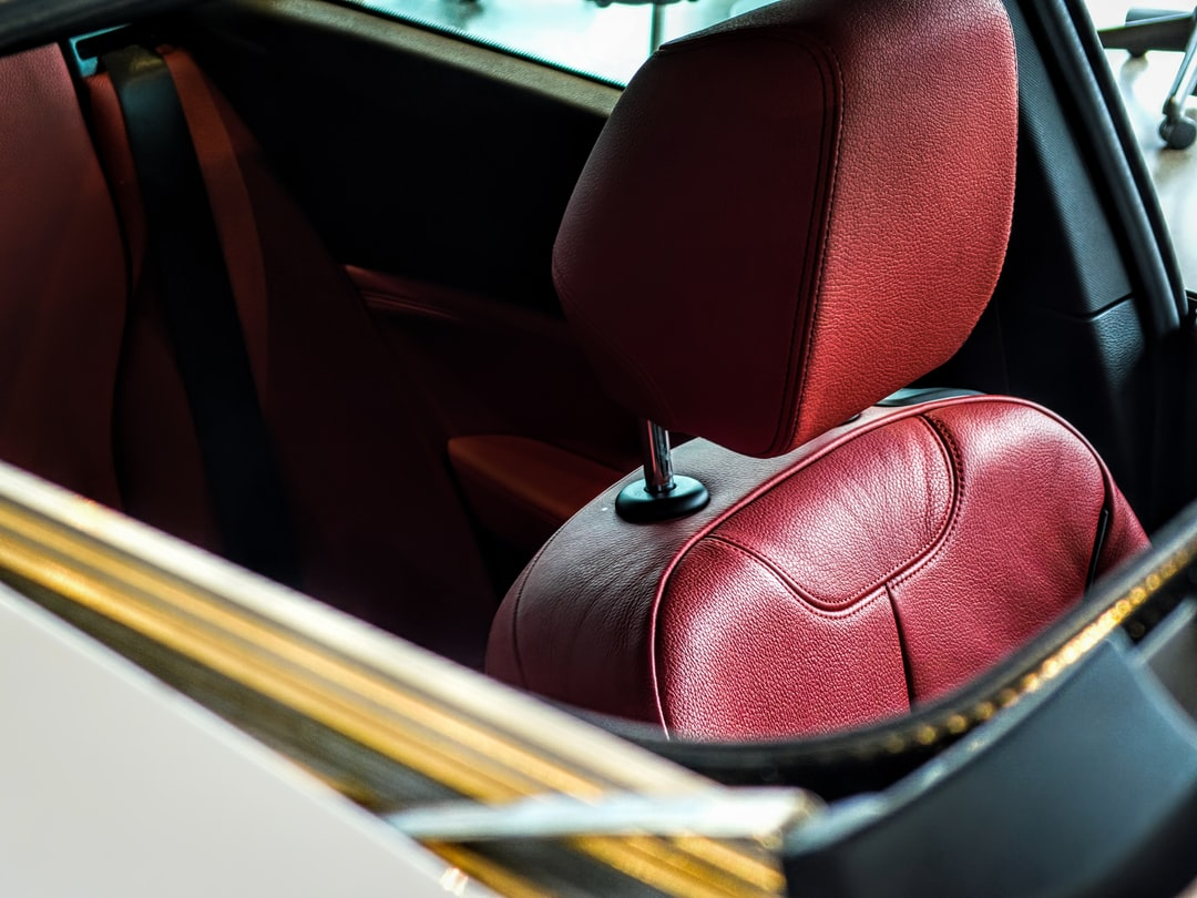 The view when looking through a Mercedes Benz C300 Sunroof showcases the rich red leather interior.
