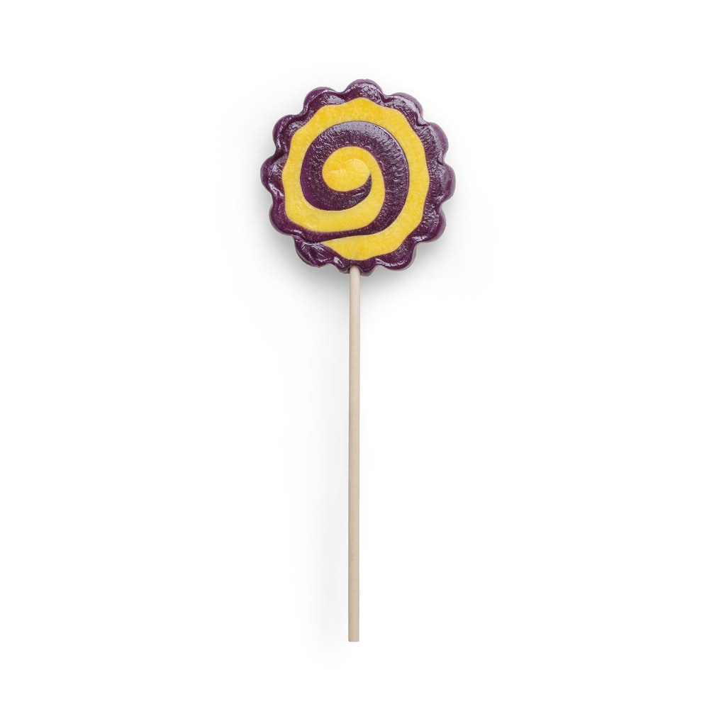 purple and yellow lollipop with white background