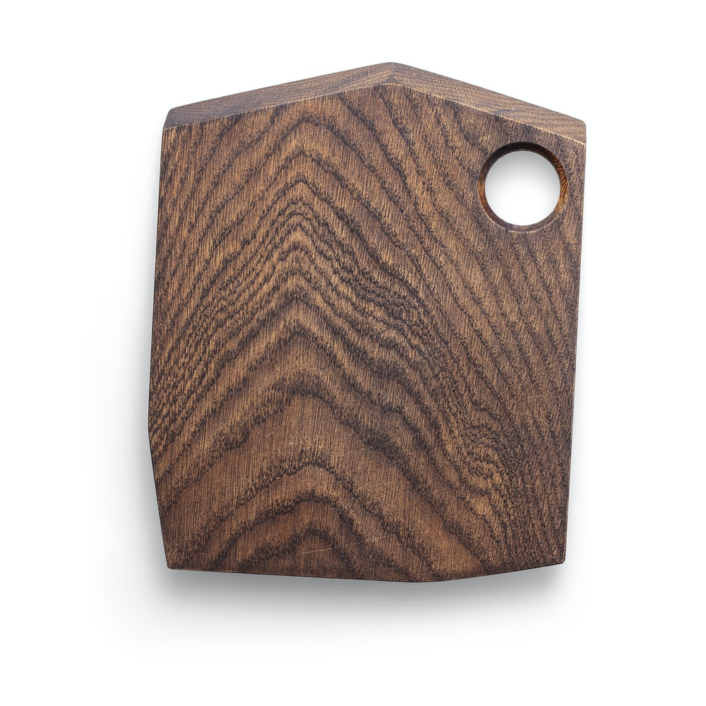 brown wooden chopping board on white surface