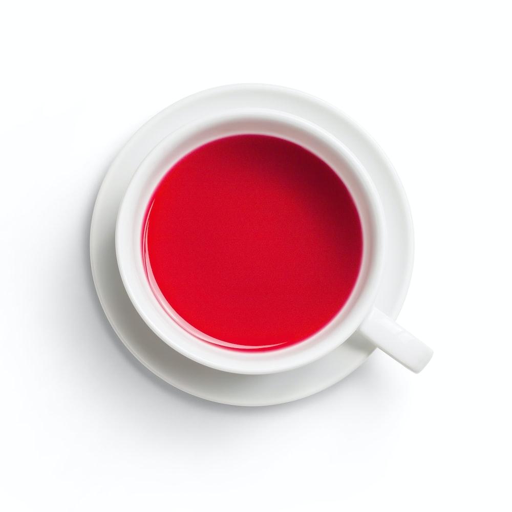 white ceramic mug with red liquid