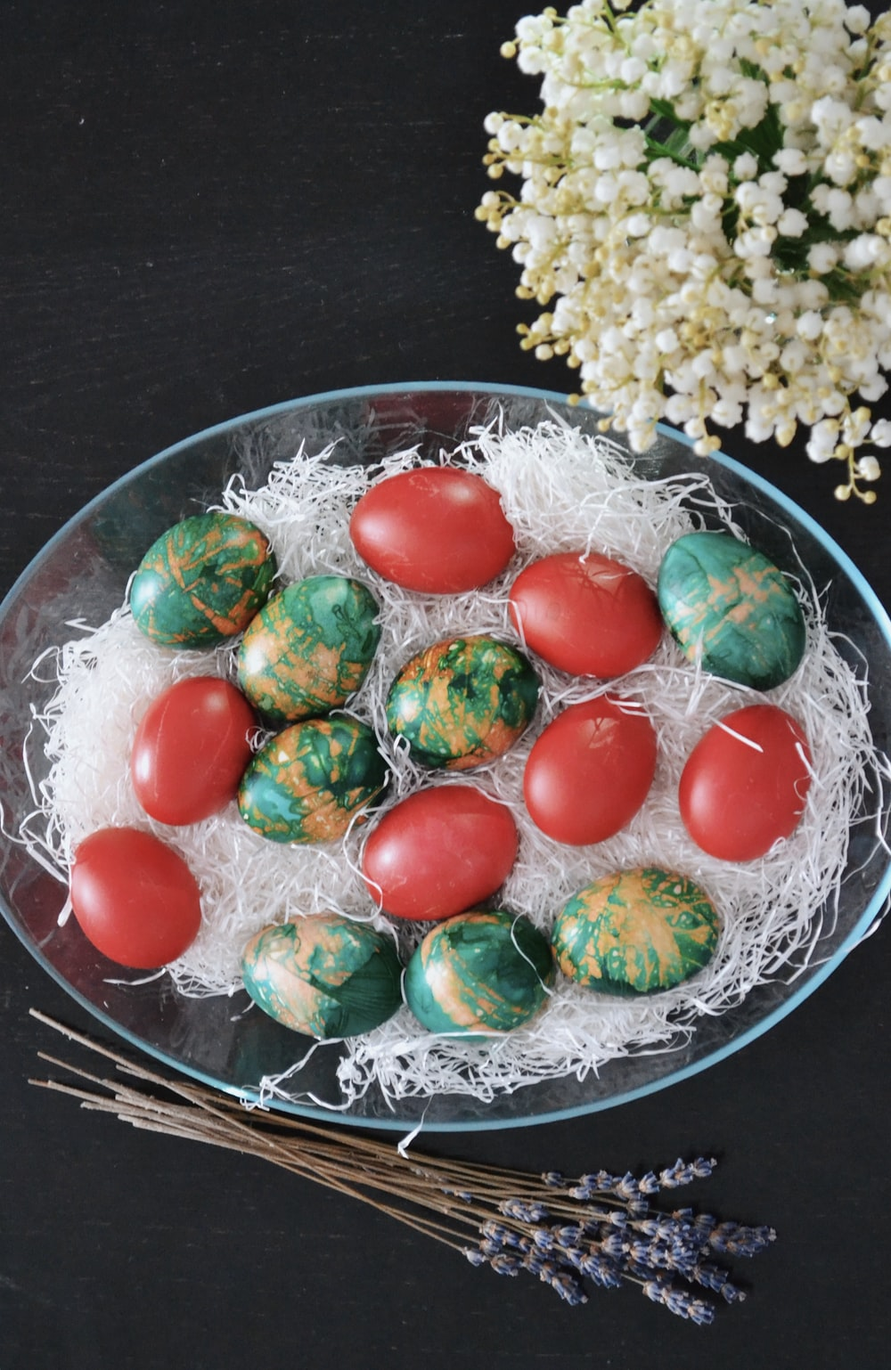 red green and yellow candies on clear glass bowl