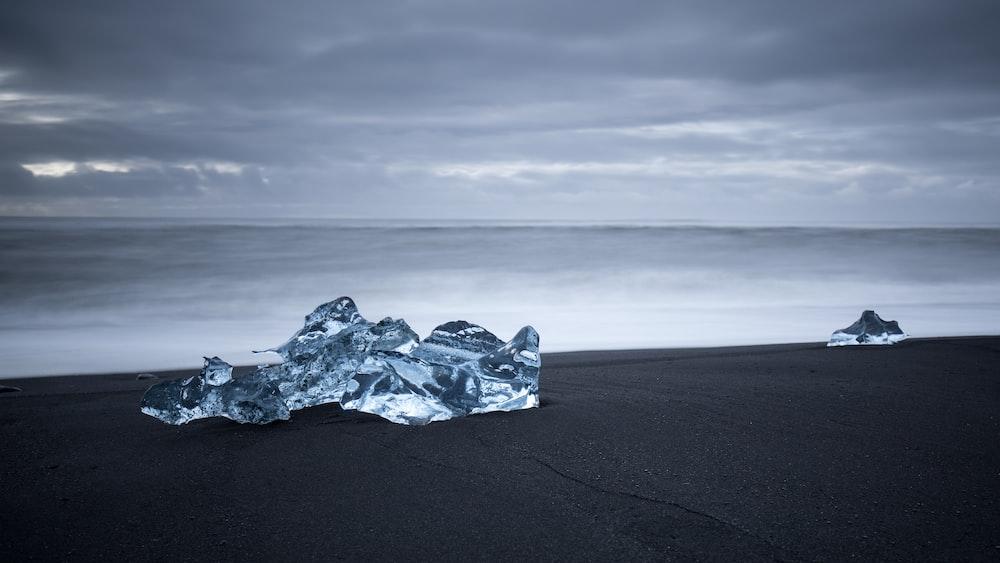 ice blocks on black sand