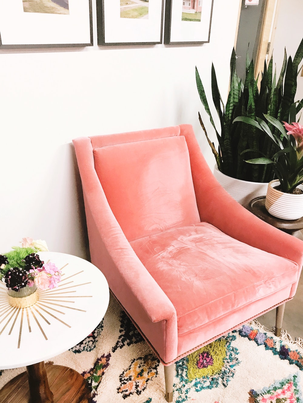 pink sofa chair beside white round table