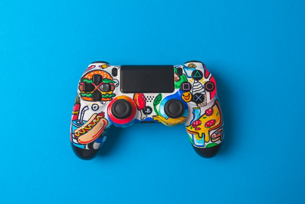 green and orange camouflage ps 4 game controller