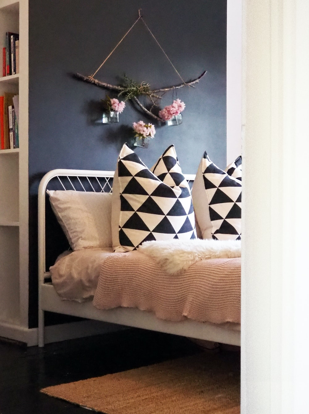white and black throw pillows on white couch