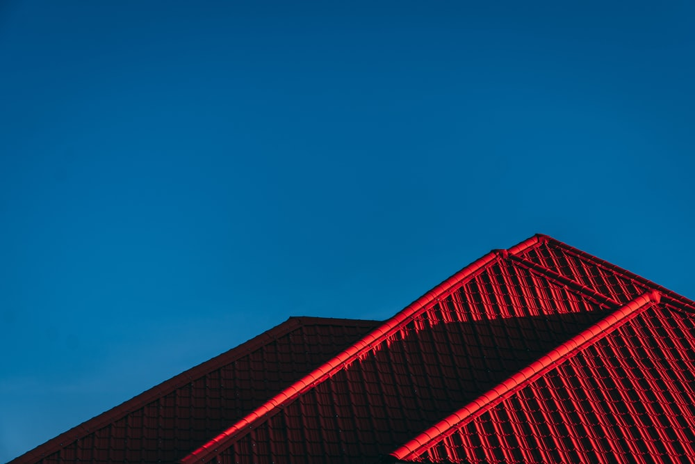 red and black building under blue sky
