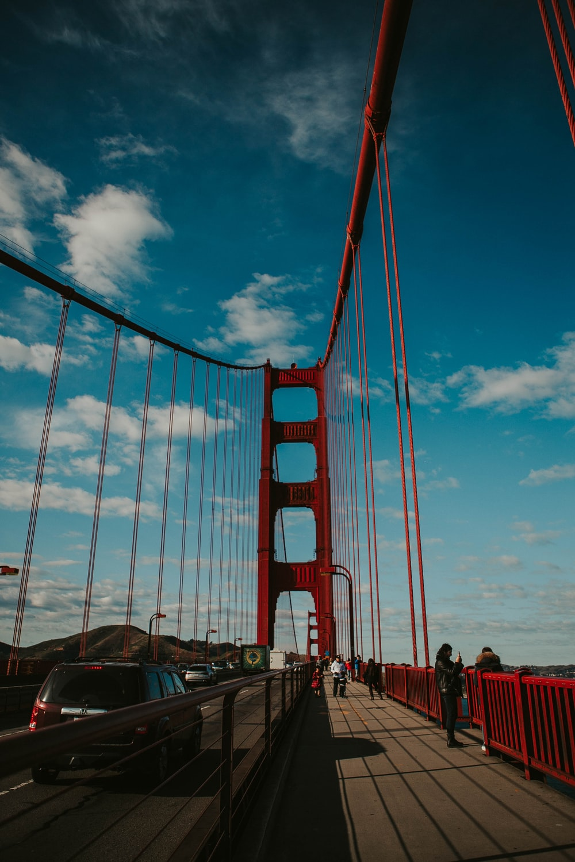 cars on bridge under blue sky during daytime