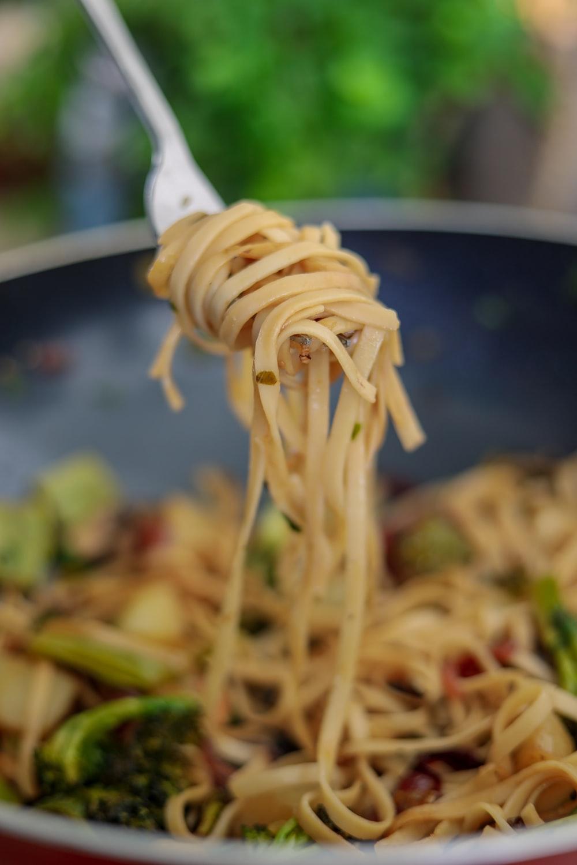 pasta dish on black round plate