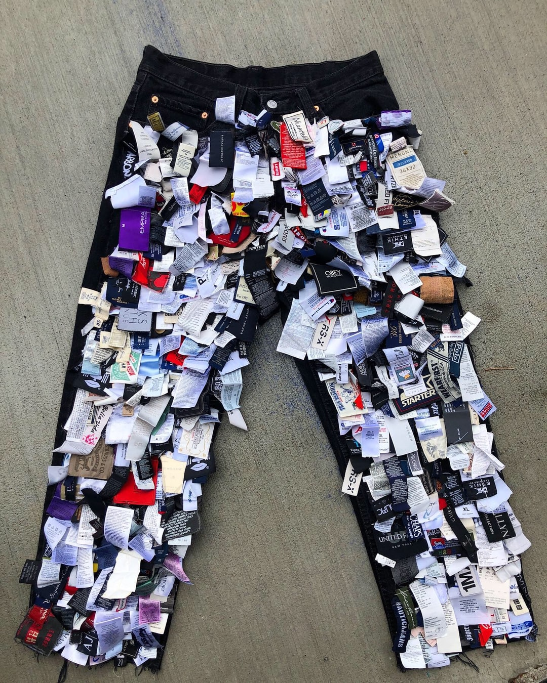 """""""Tag Pants"""" I handmade for Kid Super NYFW SS2020. These pants took nearly 30 hours to make. Each tag was sewn individually. Over 500 tags recycled."""