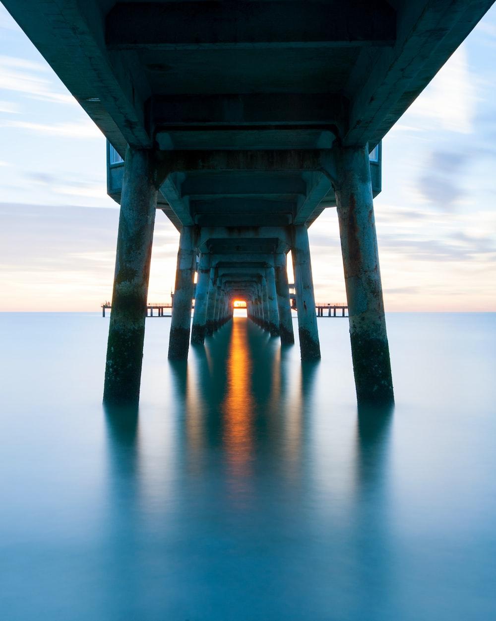 gray concrete bridge over the sea