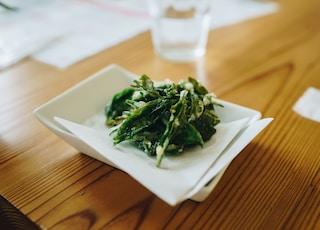 green vegetable on white ceramic plate