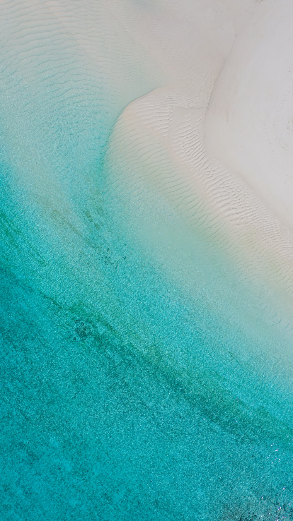 white and blue ocean water