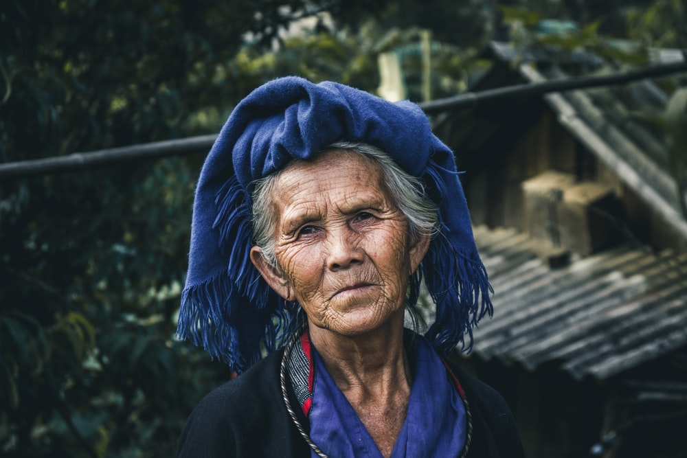 woman in blue scarf and black jacket