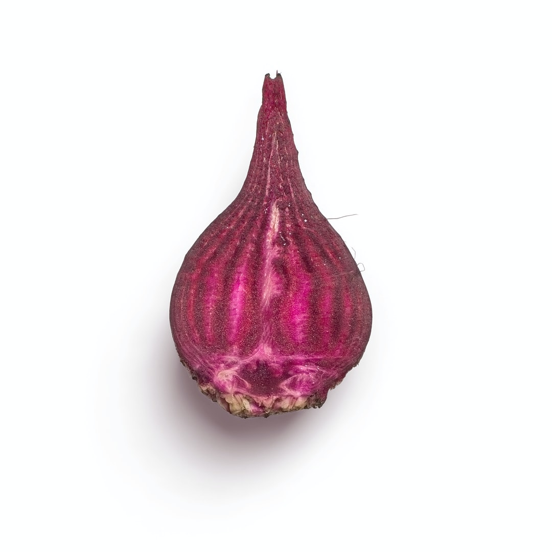 High-quality photo of a beet cut on a white background