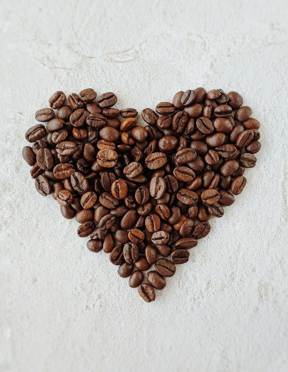 brown coffee beans on white textile