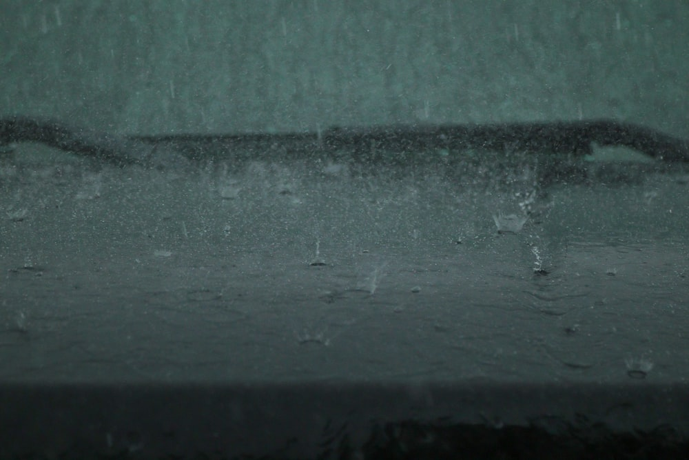 water droplets on gray concrete wall
