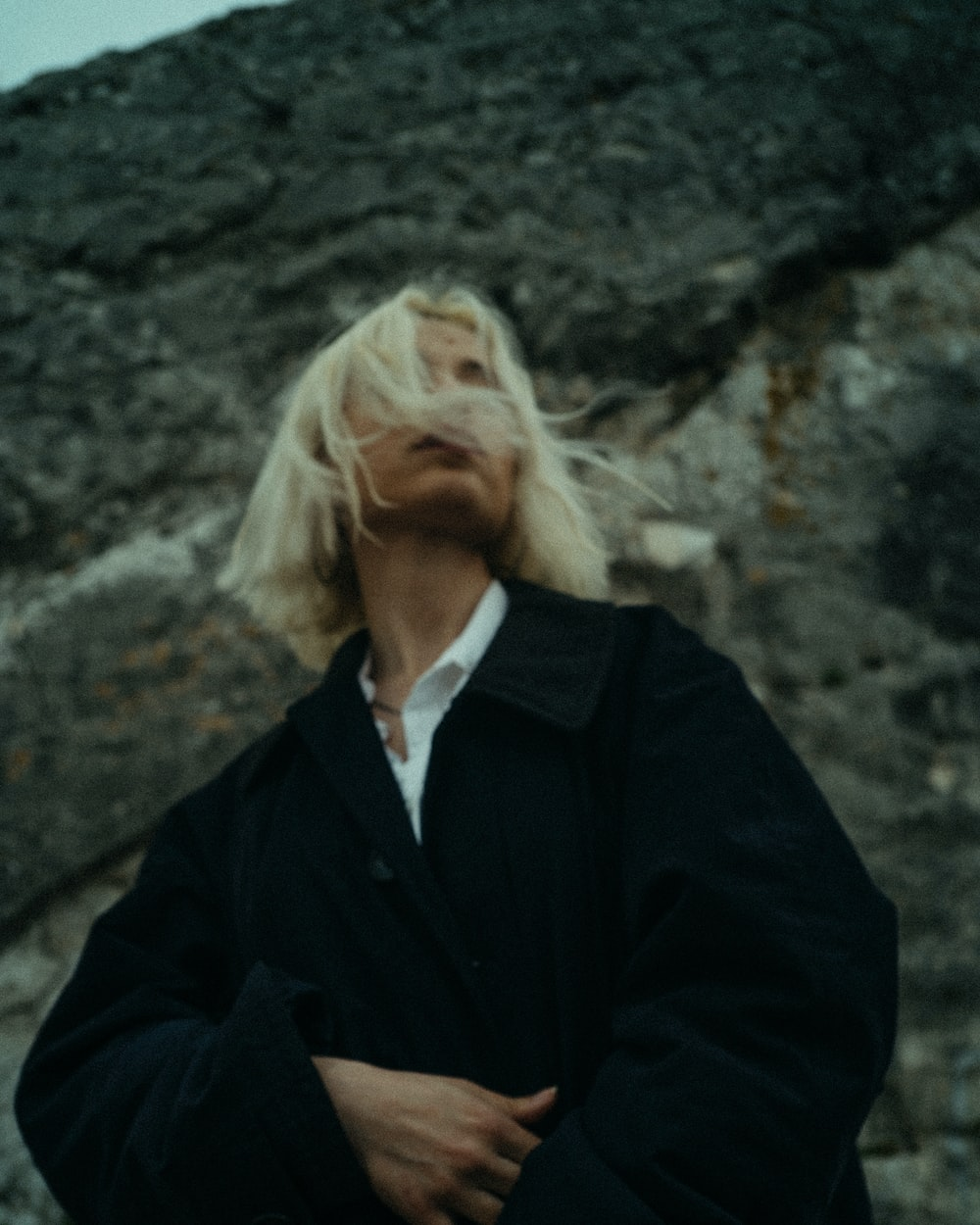 woman in black blazer standing
