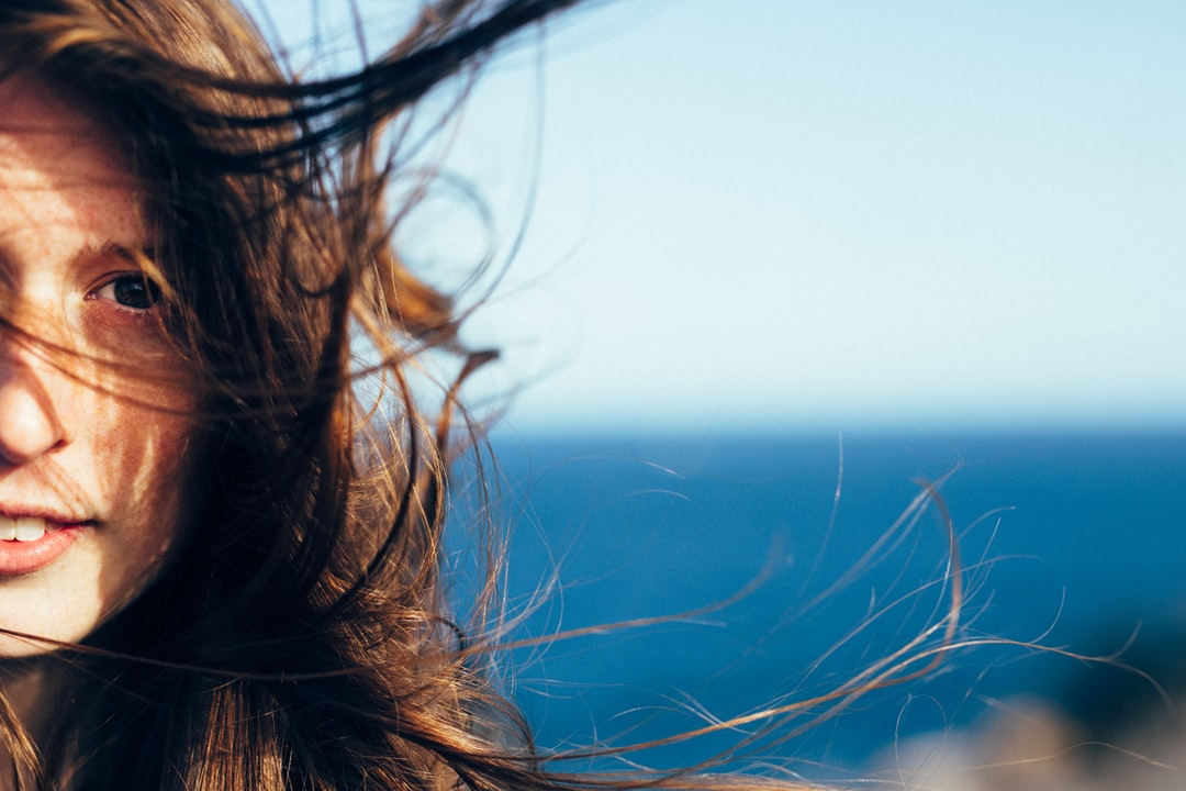 Close up of girls face with her hair blowing in the wind