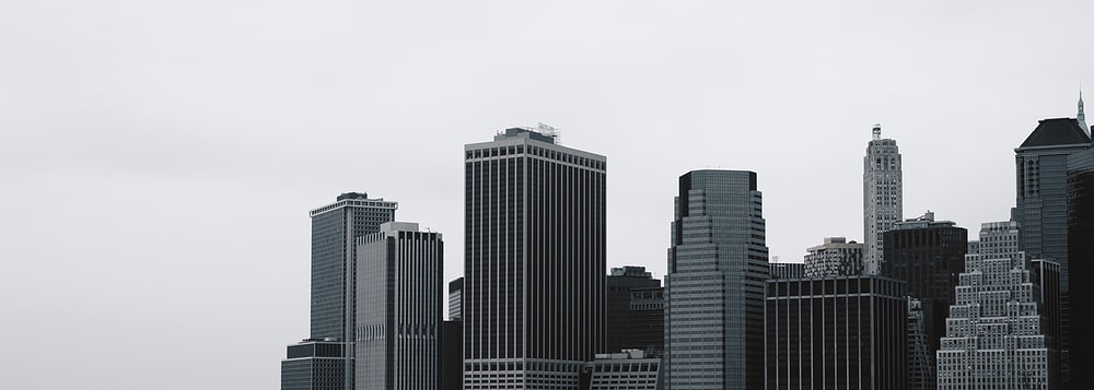 city buildings under white sky during daytime