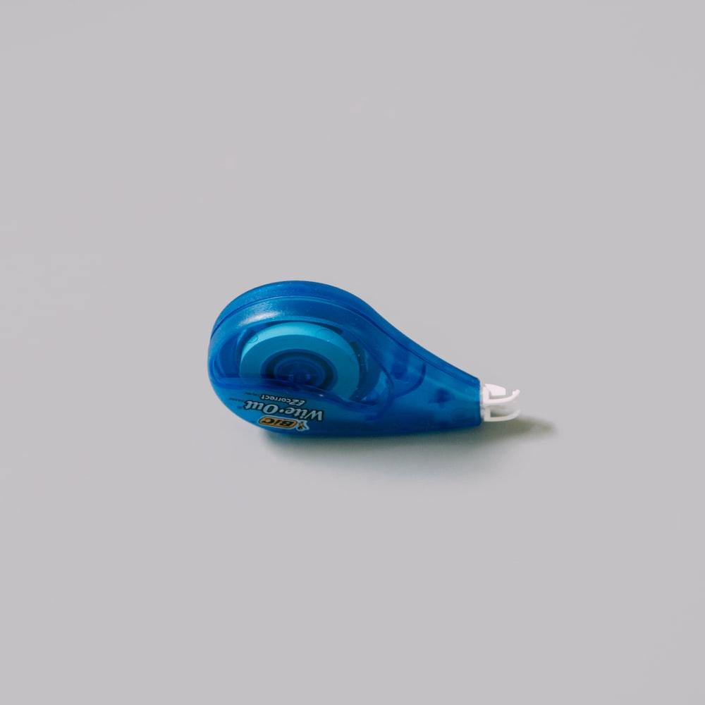 blue plastic bottle on white table