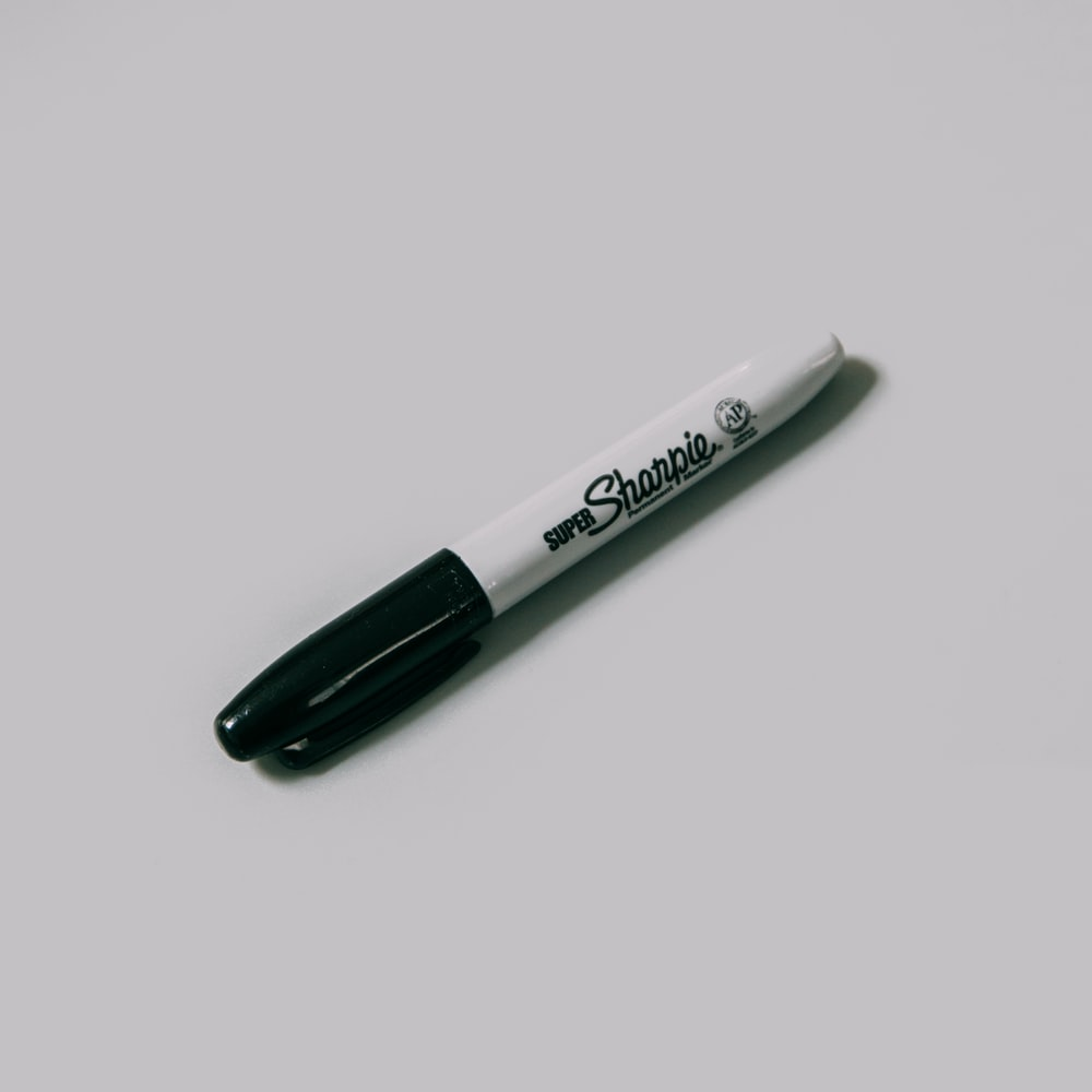 sharpie fine point pen on white surface