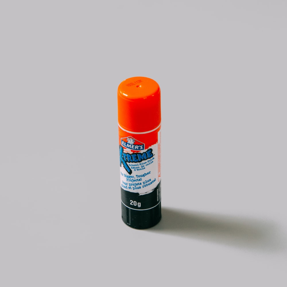 orange and white plastic bottle