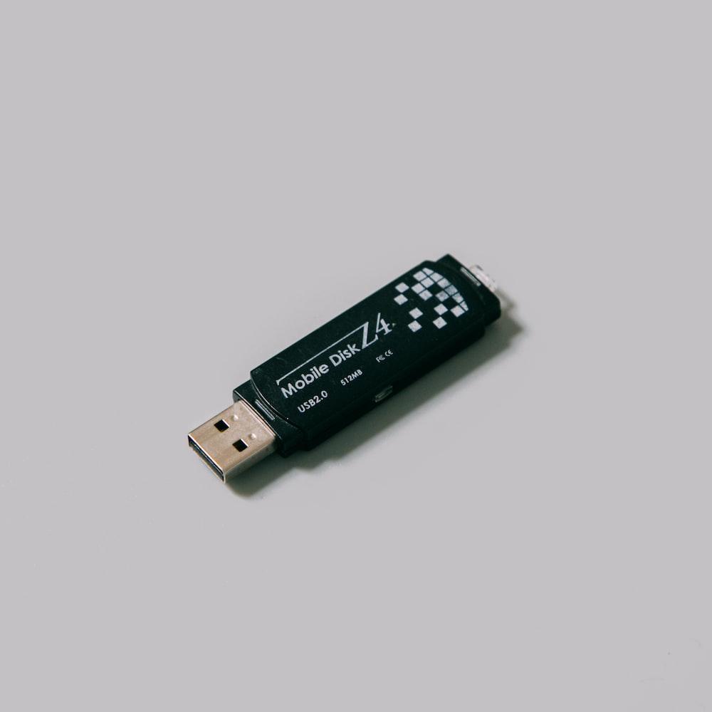 black usb flash drive on white surface